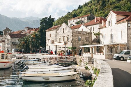 Montenegro, Perast, May 05, 2019: Beautiful view of the old coastal town of Perast in Montenegro with beautiful architecture, the sea and boats on the background of the mountains. Redactioneel
