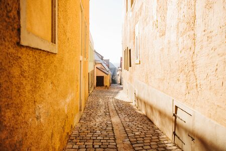 Authentic narrow street in Rothenburg ob der Tauber in Germany.