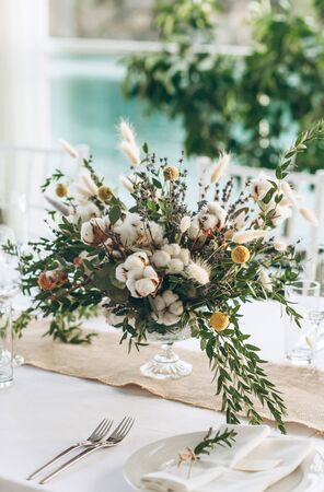 Table decoration for a ceremony or celebration. Beautiful flowers on the table in rustic style.