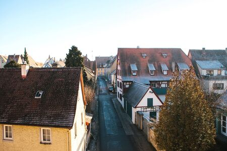 Authentic street with traditional residential buildings in Rothenburg ob der Tauber in Germany.