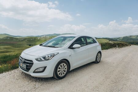 Montenegro, Zabljak, July 19, 2019 White modern Hyundai i30 car on a rural road during a road trip.
