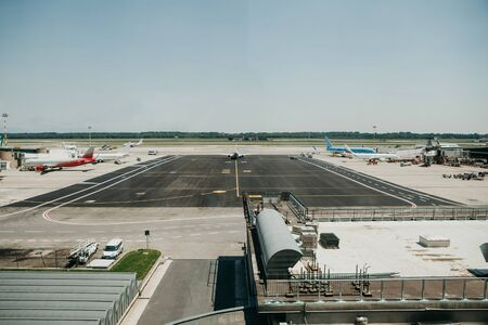 View of the runway at the airport and other airport architecture.