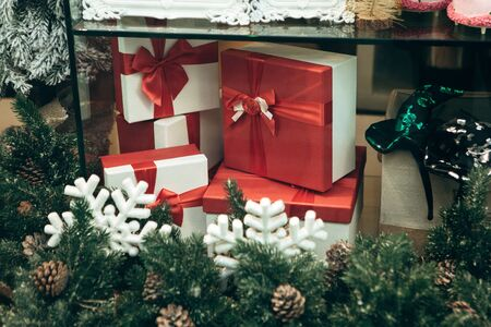Holiday Christmas or New Year boxes with gifts or for gifts in a shop window