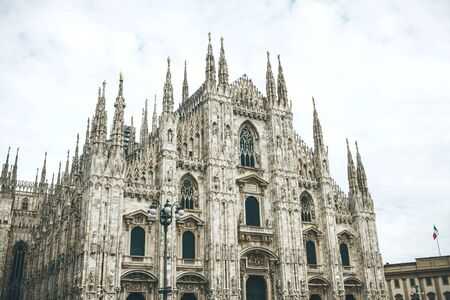 Beautiful view of the ancient Duomo Cathedral in Milan in Italy. It is one of the most popular tourist attractions in Italy. Zdjęcie Seryjne