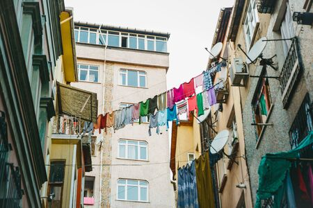 Authentic traditional residential courtyard in the Balat district of Istanbul in Turkey. Linen hanging to dry.