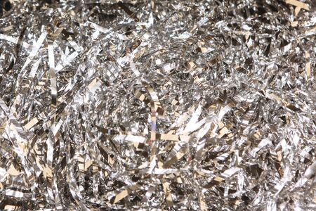 Silvery Sliced Tangled Tape Foil Abstract Background