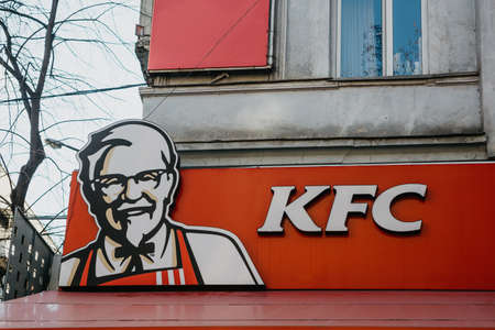 Georgia, Tbilisi, February 25, 2020: KFC sign at the entrance to a fast food restaurant - Kentucky fried chicken.