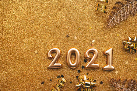 Gold numbers 2021 on a golden rich festive background. Celebrating New Year and Christmas concept.