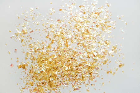 Beautiful festive white background with golden confetti. Reklamní fotografie