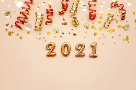 Gold numbers 2021 on a pink background with holiday decorations. New Year and Christmas background. Reklamní fotografie
