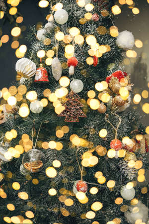 Christmas tree decoration festive background. Various toys and baubles and holiday lights on the tree. Reklamní fotografie