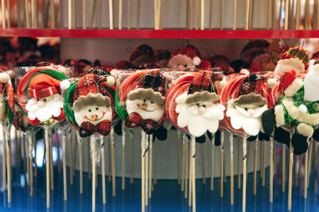 Traditional Christmas lollipops in a row at a Christmas market or shop.