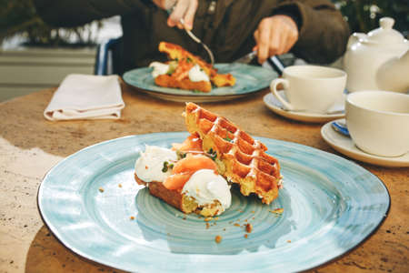 Belgian waffles with salmon and avocado on breakfast Standard-Bild