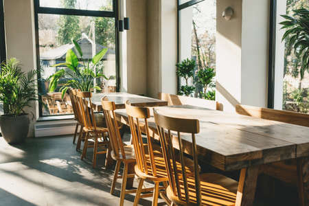 Empty wooden tables and chairs. Rustic interior.