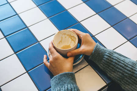 A cup of drunk coffee in the hands Standard-Bild