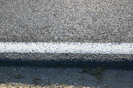 blacktop: Country road tarred, close-up with white line