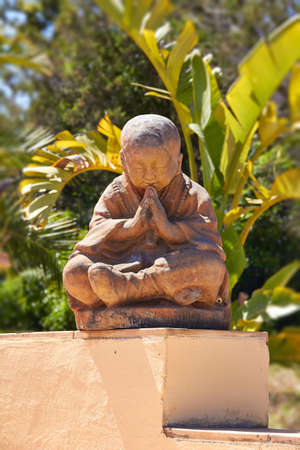 Sitting Buddha Meditation against Green Plants Background  Archivio Fotografico