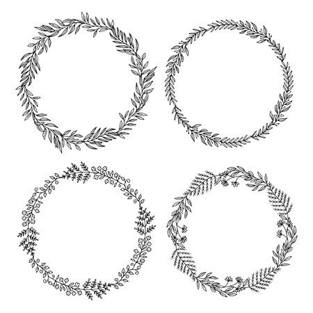 Imposta no. 2 di quattro corone floreali fatte di foglie e fiori disegnati a mano. Archivio Fotografico - 84080554