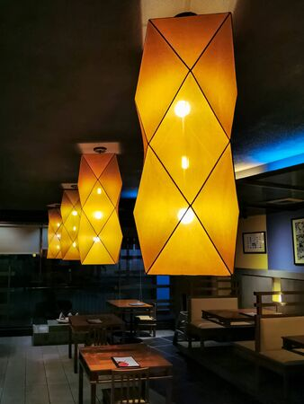This shot shows a rows of light within the restaurant.
