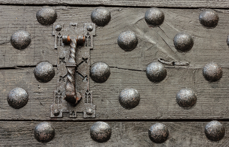 woden: particular of woden door black of a castle with a series of iron nails and its clapper Stock Photo