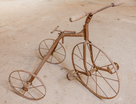 antique tricycle: close-up of an old  childrens  tricycle  1930