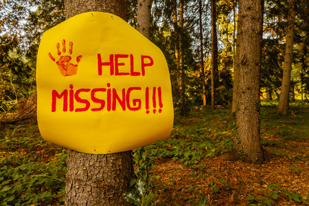help the missing sign hanging on a tree woods Stock Photo