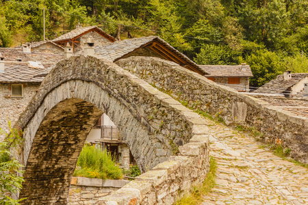 a romanesque bridge made of donkey back of  of the 17th century, at the entrance to the village of Fondo ,in Piedmont,Italy