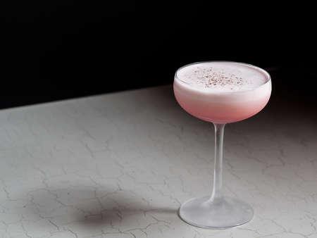Elegant pink cocktail on black and white background Banco de Imagens