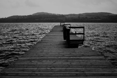 loch lomond: Looking along the length of a jetty at Loch Lomond Stock Photo