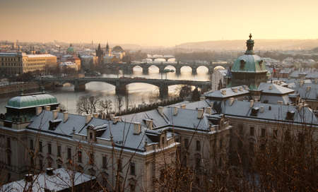 Pragues roofs. Vltava river and Charles bridge. Stock Photo