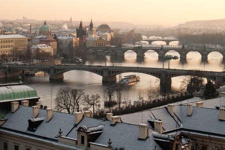 Pragues roofs. Vltava river and Charles bridge. photo