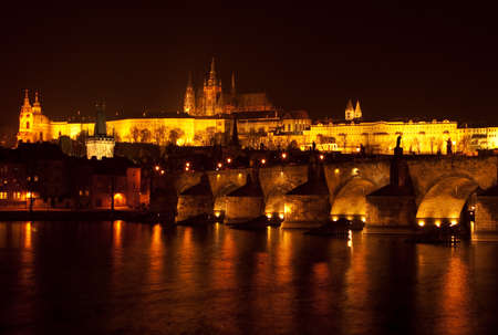 ceska: Prague castle and charles bridge at night.