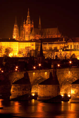 Prague castle and charles bridge at night. photo