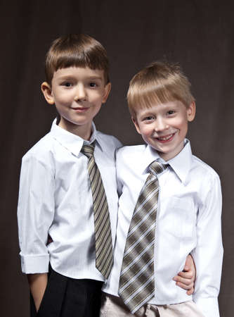 two brothers with shirt and tie. smiling boys. photo
