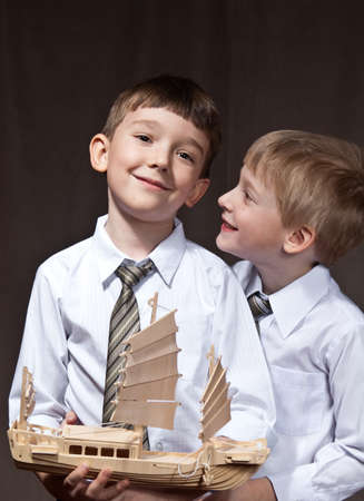 two brothers with shirt and tie. smiling boys with ship photo