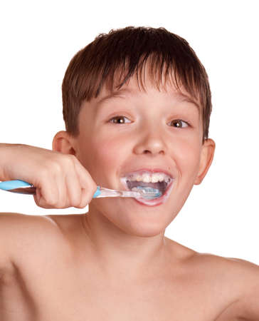 A boy brushing his teeth isolated on white background. photo