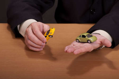dream car: Businessman playing with his dream car Stock Photo