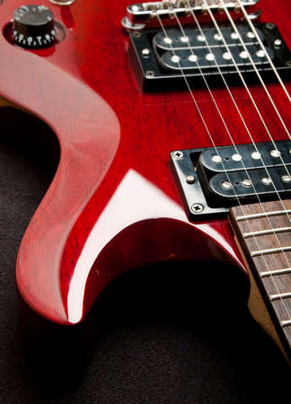Detail of a wine red color electric guitar. photo
