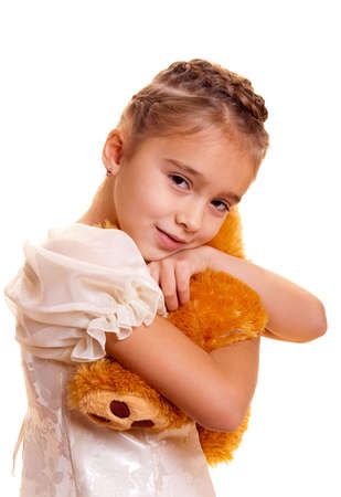 A cute little girl embracing teddy bear photo