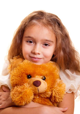 one girl only: A cute little girl embracing teddy bear Stock Photo