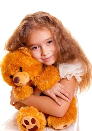 cute girl with teddy bear: A cute little girl embracing teddy bear Stock Photo
