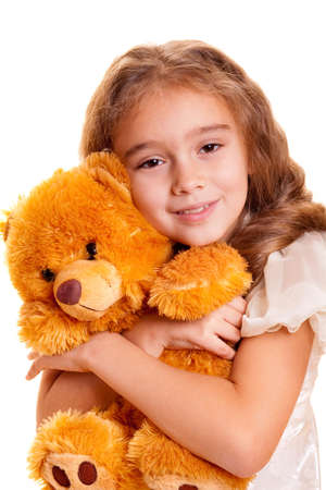 A cute little girl embracing teddy bear Stock Photo - 5887350