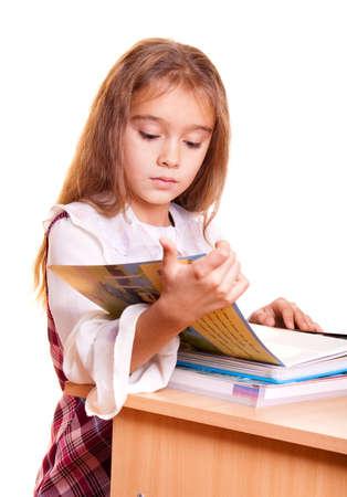 Little School Girl reading a book photo