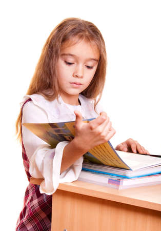 Little School Girl reading a book photo
