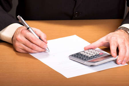 writing instrument: Image of writing instrument in male hands on a workplace Stock Photo