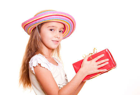 public celebratory event: Little girl in straw hat holding gift boxes in hand
