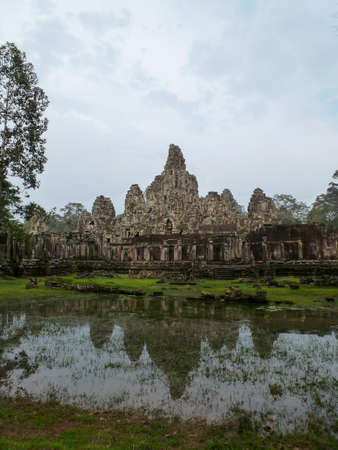 Bayon Temple is reflected in a lake Stock Photo