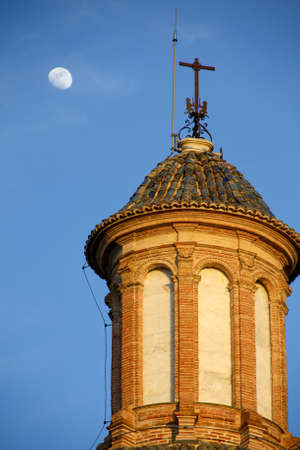Cathedral of Valencia with the moon and blue sky