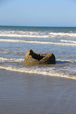 A hollow Moeraki Boulder at the beach