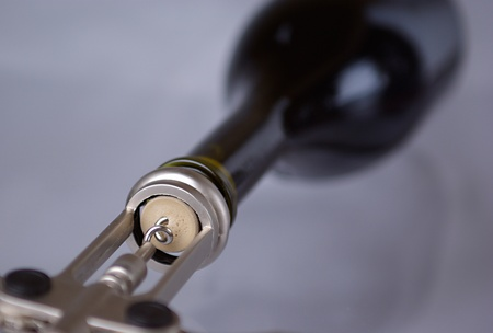the corkscrew opens a wine bottle. focus is on the cork Stock Photo - 13251947
